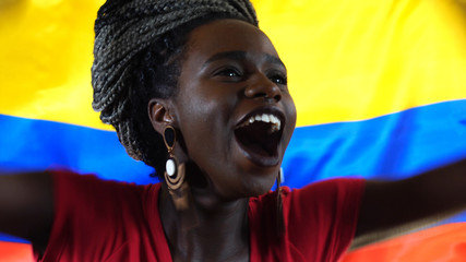 Colombian Young Black Woman Celebrating with Colombia Flag