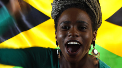 Jamaican Young Black Woman Celebrating with Jamaica Flag