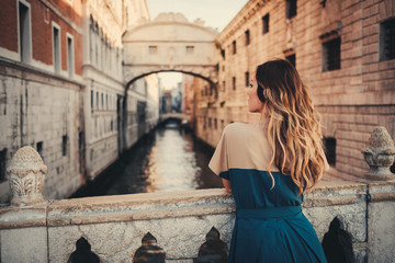 Woman in front of Bridge of Sighs in Venice