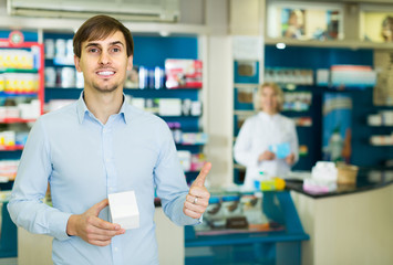 Portrait of two pharmacists working in modern farmacy