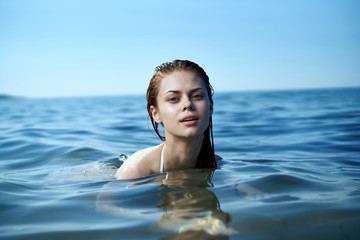 Beautiful woman is swimming in the sea, portrait