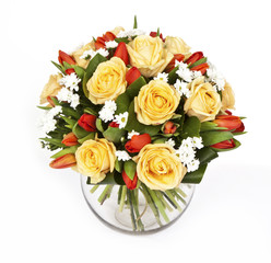 bouquet of yellow roses and red tulips in vase isolated on white background