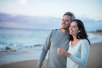 Portrait of a couple walking on the beach