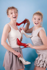 Women presenting high heels shoes
