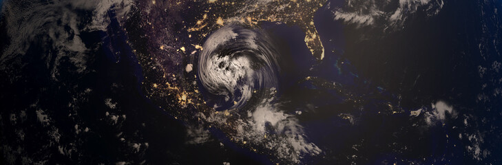 Extremely detailed and realistic high resolution 3D illustration of a hurricane approaching Texas at night. Shot from Space. Elements of this image are furnished by Nasa.
