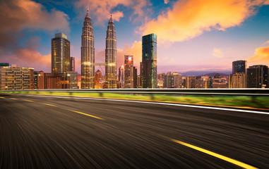 Fotobehang Las Vegas Speedy motion forward flyover with beautiful Kuala Lumpur city skyline , Sunset scene .