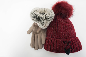 isolated fluffy wool hat and women leather gloves for winter