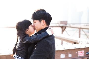Daughter kisses her dad gently on Brooklyn bridge