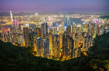 Night light cityscape of Central District and Kowloon, Hong Kong. Scenery aerial view from the peak mountain.