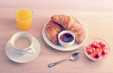 continental Breakfast - coffee, croissant with jam, strawberries and orange juice