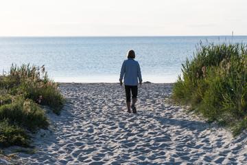 Walking to the beach a summer evening