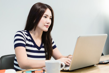 Young Woman in Startup Environment