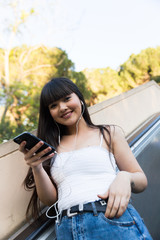 Eurasian woman listening to music in Barcelona