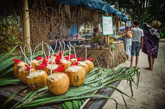 Exotic coctails made of fresh coconuts and the tourists, Seychelles