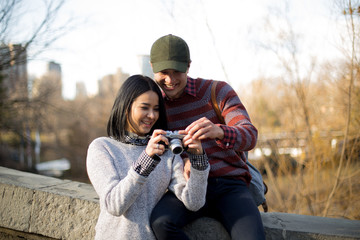 Photographer couple taking pictures in Central park