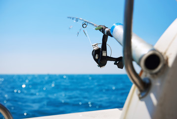 Fishing rod and Mediterranean Sea, selective focus