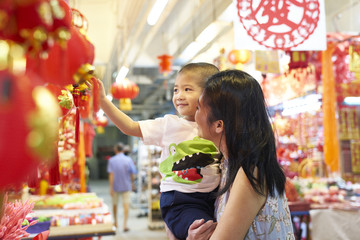 Siblings shopping for decorations in Chinatown
