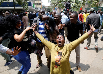 Supporters of opposition leader Raila Odinga cheer outside court after President Uhuru Kenyatta's election win was declared invalid in Nairobi