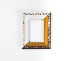 ornate, elegant, golden blank frame on a white background