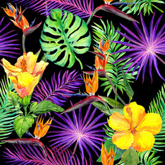 Tropical leaves, exotic flowers. Seamless pattern on black background. Watercolor