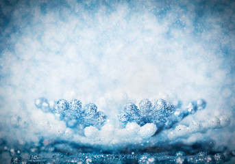 Cold winter glitter background with snowflake