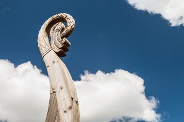 carved bird's head on a boat Viking Drakkar in Vyborg. Russia
