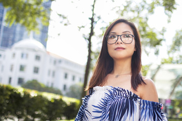 Pretty Asian Girl With Glasses In The Street