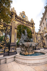 Details of the city square in Nancy with its golden fence and fountains