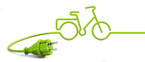 Green power plug lying on the floor and bent in a bicycle shape