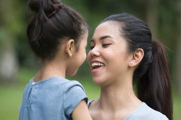 Mom Smiling At Child