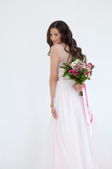 Beautiful Bride Woman Fashion Model with Colorful Flower Arrangement