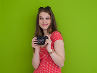 smilling girl taking photo on a retro camera