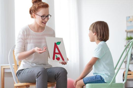 Friendly speech therapist and boy