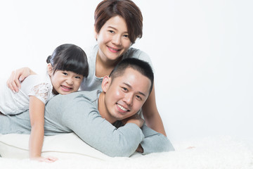 Young happy Asian family