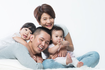 Young happy Asian family with kids
