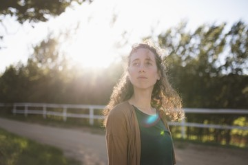 Woman looking away at farm