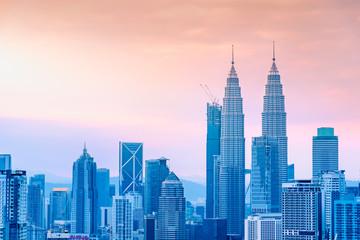 Landscape of Kuala Lumpur skyscraper with colorful sunrise sky, Malaysia.