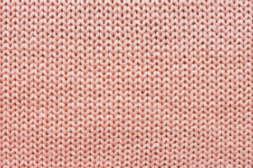 Openwork pattern on the knitted product with spokes made of woolen thread in pink, handmade