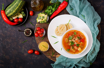 "Minestrone - ""big soup"", soup with many ingredients - a dish of Italian cuisine, light seasonal vegetable soup with pasta."