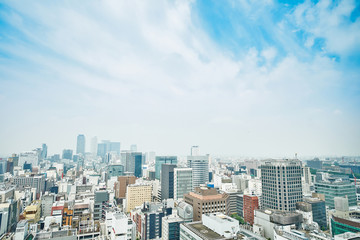 Fototapete - Business concept - panoramic modern city skyline bird eye aerial view with spiral tower and midland square under dramatic cloud and morning bright blue sky on Nagoya TV Tower in Nagoya, Japan