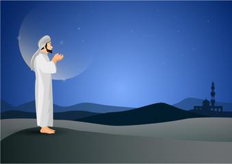man praying  on moon background