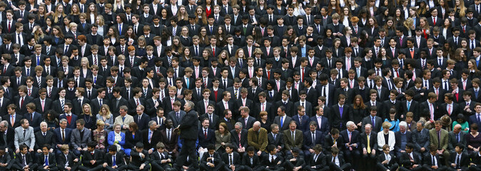 Westminster School students gather for a group photograph outside Westminster Abbey in London