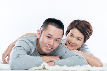 Young happy Asian couple looking at the camera