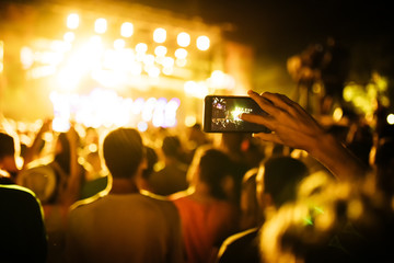 People Taking Photos At A Music Concert