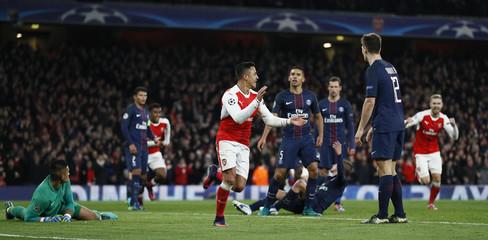 Arsenal's Alexis Sanchez celebrates after Paris Saint-Germain's Marco Verratti scores an own goal and the second goal for Arsenal