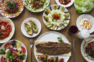 Kebab; healthy and fresh salad varieties and appetizer on wooden table