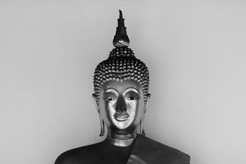 Face of buddha statue - light and shadow