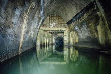 Flooded by wastewater sewage collector. Sewer tunnel under city