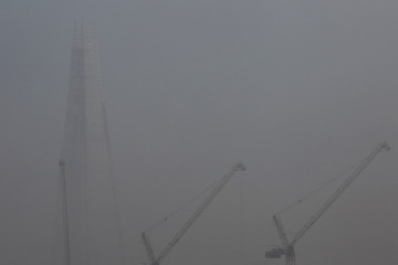 Fog surrounds the Shard building in London