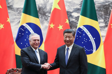 Chinese President Xi Jinping shakes hands with Brazilian President Michel Temer during a signing ceremony at the Great Hall of the People in Beijing, China